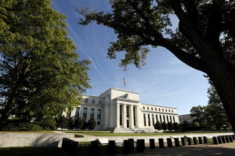 US Federal Reserve Raises Key Interest Rate, Signals More Hikes Coming
