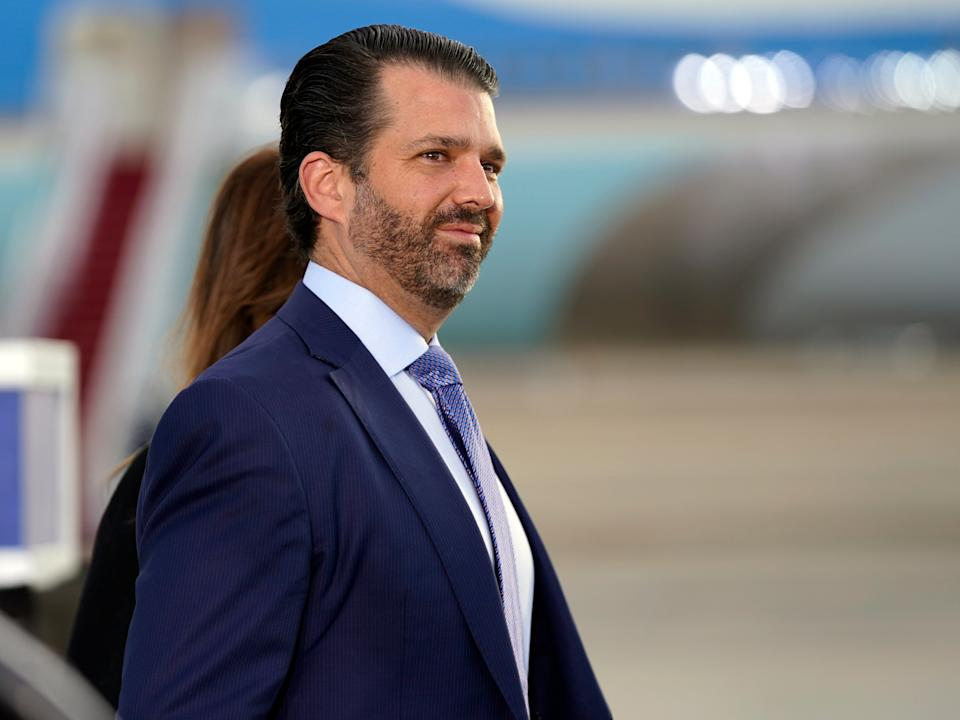 <p>Donald Trump Jr. waits for President Donald Trump and First Lady Melania Trump to arrive and board Air Force One </p> (AP)