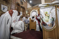 Coptic Orthodox deacons pray during Easter mass, at Holy Cross Church in Cairo, Egypt, Saturday, May 1, 2021. Orthodox Christians around the world celebrate Easter on Sunday, May 2. (AP Photo/Nariman El-Mofty)