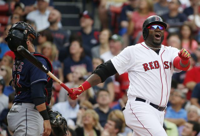 Boston Red Sox's David Ortiz, right, reacts to a pop foul in front of Cleveland Indians catcher Yan Gomes during the first inning of a baseball game in Boston, Saturday, June 14, 2014. (AP Photo/Michael Dwyer)