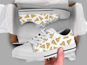 <p>Upgrade their kicks with these <span>Pizza Printed Sneakers</span> ($65, originally $87). They'll love wearing these sneakers out and about, especially to their local pizza place. </p>