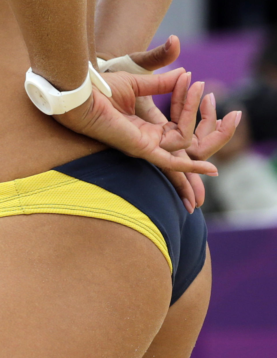 Talita Rocha of Brazil signals her partner during a beach volleyball match against Germany at the 2012 Summer Olympics, Tuesday, July 31, 2012, in London. (AP Photo/Dave Martin)