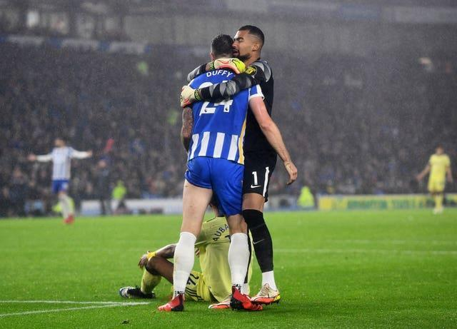 Brighton and Hove Albion's Shane Duffy is embraced by keeper Robert Sanchez after thwarting Pierre-Emerick Aubameyang