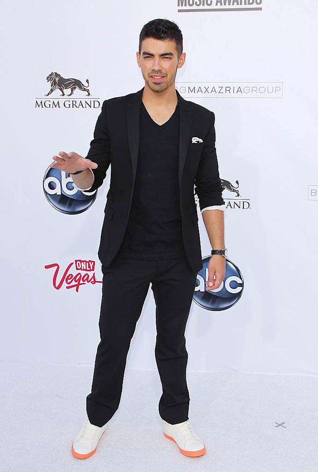"<b>Joe Jonas:</b> Joe added an unexpected twist to the all-black ensemble he wore to the 2011 Billboard Music Awards with some bright white kicks! (05/22/2011)<br><br><a target=""_blank"" href=""http://www.seventeen.com/beauty/celebrity/crazy-nails?link=emb&dom=yah_omg&src=syn&con=slide&mag=svn"">Crazy Celebrity Nail Designs</a>"