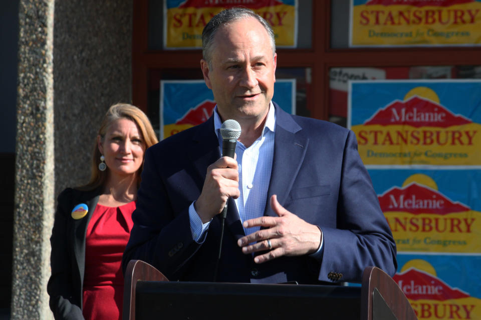 Doug Emhoff, the husband of Vice President Kamala Harris, campaigns in New Mexico on behalf of Democratic congressional candidate Melanie Stansbury, background, during a rally in Albuquerque, New Mexico, on Thursday, May 27, 2021. The visit marked Emhoff's first such trip on behalf of a candidate. (AP Photo/Susan Montoya Bryan)