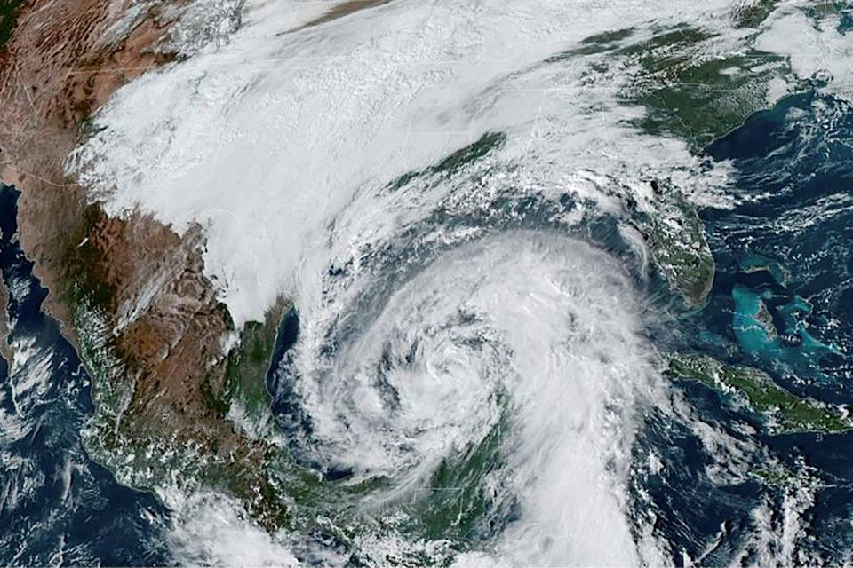 A NOAA satellite image shows Tropical Storm Zeta, which is expected to strengthen to a hurricane, in the Gulf of Mexico and approaching the coast of Louisiana on 27 October. (via REUTERS)