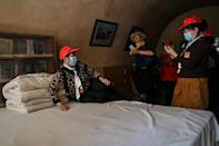 This picture taken during a government-organised media tour shows tourists at the former residence of Mao Zedong in Yan'an, the headquarters of the Chinese Communist Party from 1936 to 1947