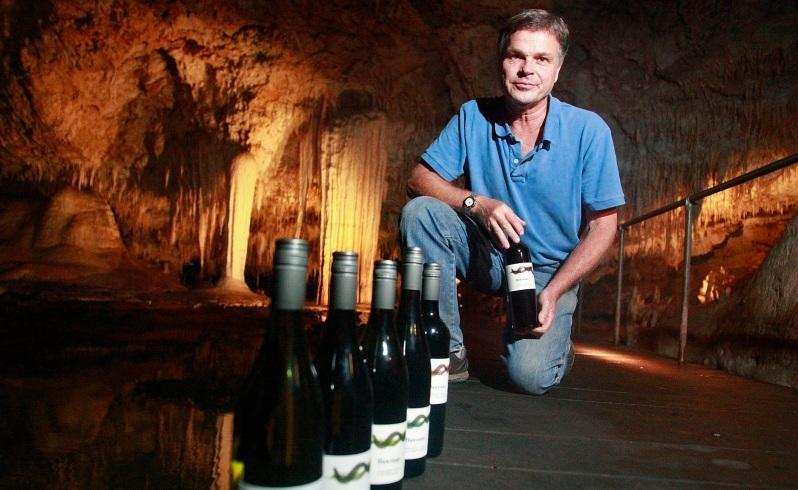 Flowstone Wine owner Stuart Pym's new label shows the relationship of the moisture from the soil in the vineyard and in Lake Cave. Picture: Becky Felstead