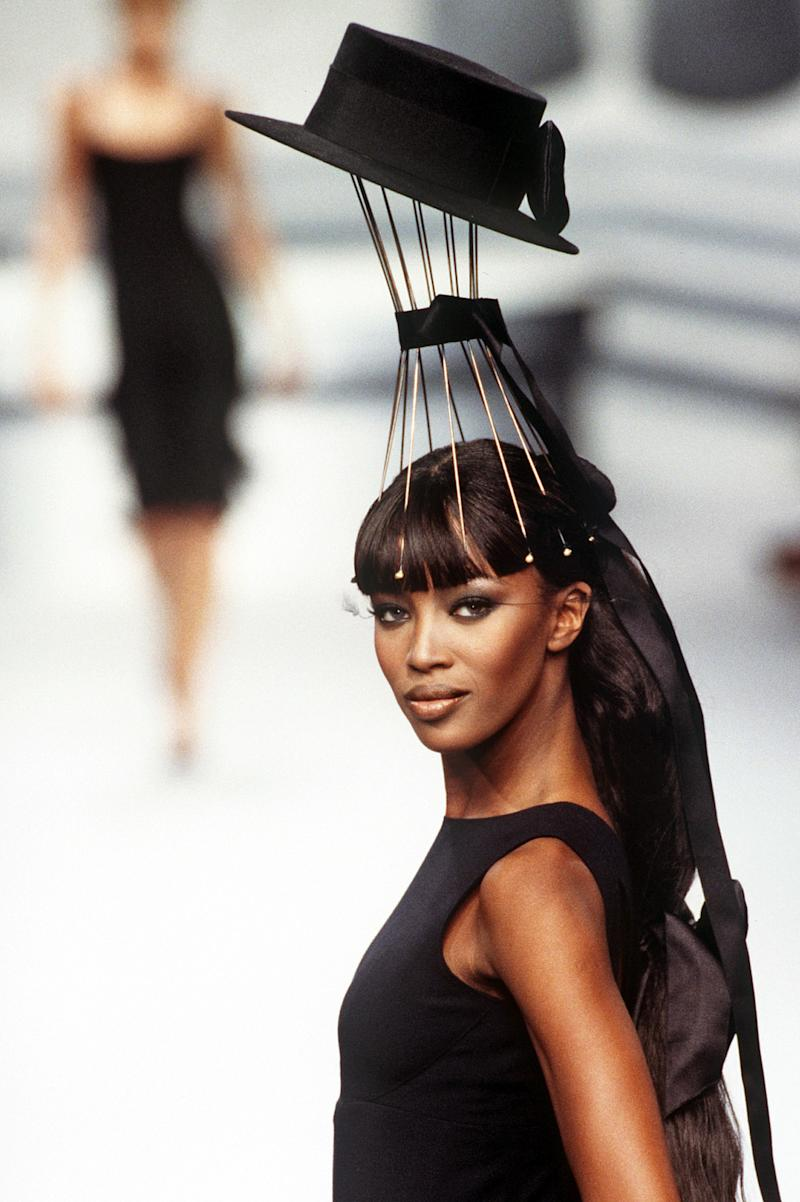 Naomi Campbell walks the runway of the Chanel fall/winter 1995 couture show Haute during Paris Fashion Week in 1995. Photo courtesy of Getty Images.
