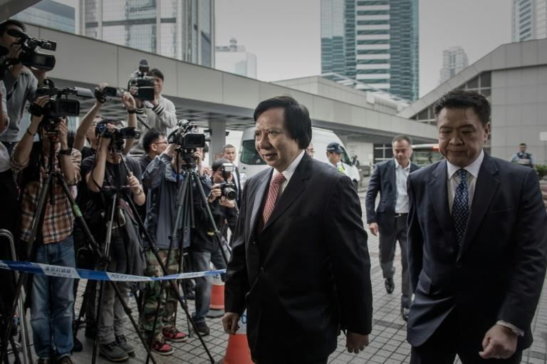 Hong Kong property tycoon Thomas Kwok (C) was jailed in 2014 over a series of payments totaling HK$8.5 mn to the city's former deputy leader Rafael Hui