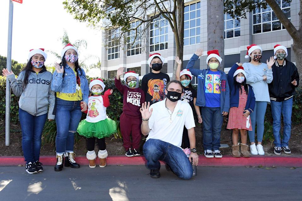 <p>Prince Jackson poses with a group of kids at the Heal L.A. event he hosted with Mattel to support underprivileged youths this Christmas in L.A. on Monday in El Segundo, California.</p>