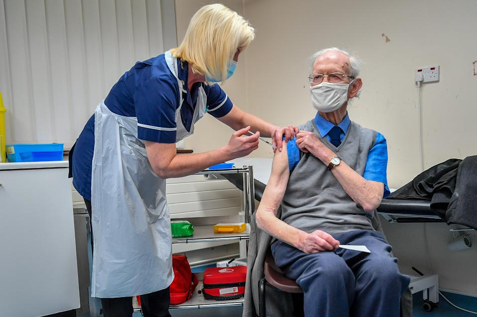 Ralph Evans, 88, receives the Oxford University/AstraZeneca COVID-19 vaccine at Pontcae Medical Practice in Merthyr Tydfil as the NHS ramps up its vaccination programme with 530,000 doses of the newly approved jab available for rollout across the UK.
