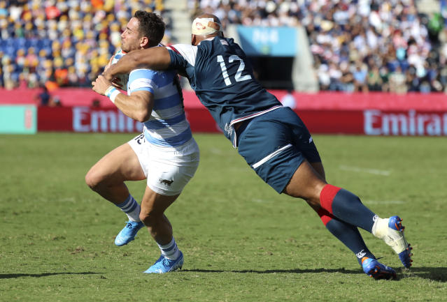 Argentina's Joaquin Tuculet is tackled by United States' Paul Lasike, right, during the Rugby World Cup Pool C game at Kumagaya Rugby Stadium between Argentina and the United States in Kumagaya City, Japan, Wednesday, Oct. 9, 2019. (AP Photo/Eugene Hoshiko)