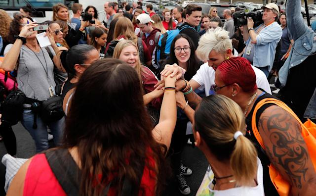 <p>Students who survived the shooting at Stoneman Douglas High School, along with survivors of the Pulse nightclub shooting, cheer before the students board a bus in Parkland, Fla., Tuesday, Feb. 20, 2018, to rally outside the state capitol and talk to legislators about gun control reform. The students plan to hold a rally Wednesday in hopes that it will put pressure on the state's Republican-controlled Legislature to consider a sweeping package of gun-control laws, something some GOP lawmakers said Monday they would consider. (Photo: Gerald Herbert/AP) </p>