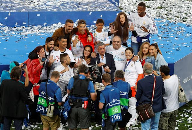 Soccer Football - Champions League Final - Real Madrid v Liverpool - NSC Olympic Stadium, Kiev, Ukraine - May 26, 2018 Real Madrid's Cristiano Ronaldo celebrates with his mother Maria Dolores dos Santos Aveiro, girlfriend Georgina Rodríguez, his son and family after winning the Champions League REUTERS/Phil Noble