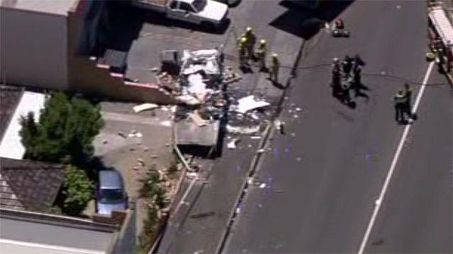 One person has died and six people have been injured after a collision between two cars and a truck caused an explosion outside a hall in Melbourne. Photo: 7News