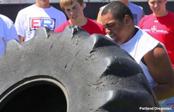 The Tire Flip competition at the Metro Area Lineman Challenge