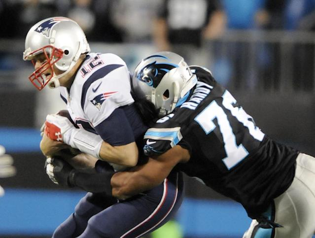 New England Patriots' Tom Brady (12) is sacked by Carolina Panthers' Greg Hardy (76) during the first half of an NFL football game in Charlotte, N.C., Monday, Nov. 18, 2013. (AP Photo/Mike McCarn)