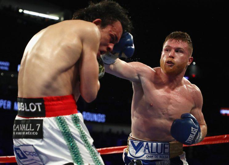 Canelo Alvarez (R) punches Julio Cesar Chavez Jr. during their fight on Saturday. (Getty)