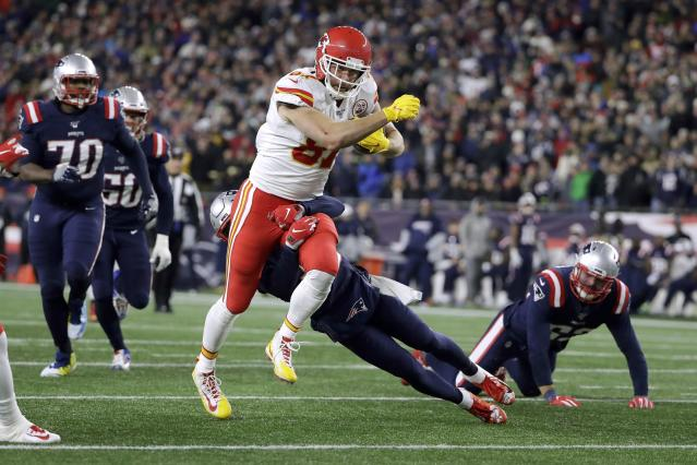 Kansas City Chiefs tight end Travis Kelce carries the ball after catching a pass against the New England Patriots in the first half of an NFL football game, Sunday, Dec. 8, 2019, in Foxborough, Mass. (AP Photo/Steven Senne)