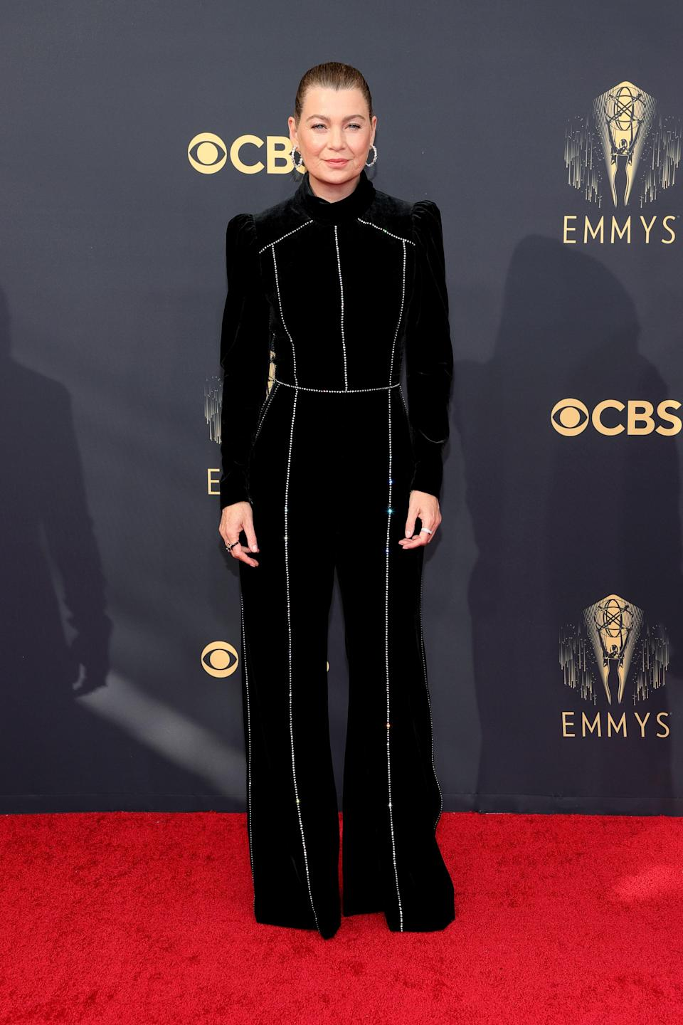 The doctor is in! Ellen wore a black jumpsuit with sparkling silver piping.