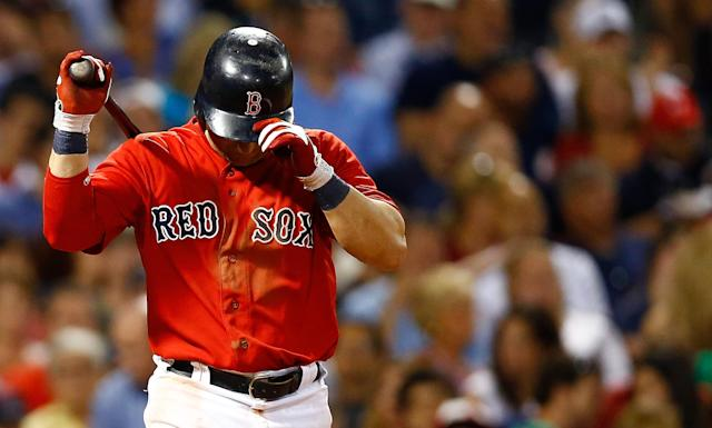 BOSTON, MA - JULY 06: Nick Punto #5 of the Boston Red Sox reacts after striking out against the New York Yankees on July 6, 2012 at Fenway Park in Boston, Massachusetts. (Photo by Jared Wickerham/Getty Images)
