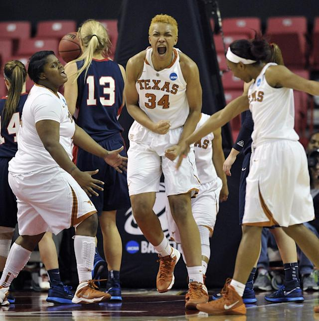 Texas players, from left to right, Nekia Jones, Imani McGee-Stafford and Empress Davenport celebrate a basket against Penn during the second half of the first round of the NCAA women's college basketball tournament on Sunday, March 23, 2014, in College Park, Md. Texas won 79-61. (AP Photo/Gail Burton)