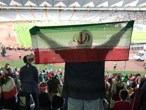 PHOTO: A woman holds the Iranian flag in the stands during the World Cup qualifying match between Iran and Cambodia at Azadi Stadium in Tehran, Iran, Oct. 10, 2019. (Somaye Malekian/ABC News)