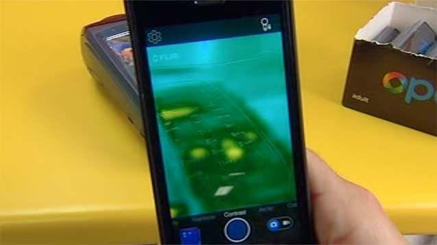 A thief is able to simply hold an iPhone handset over an EFTPOS keypad to reveal the previous customer's PIN. Photo: 7News