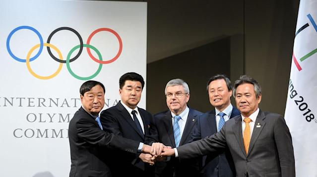 """<p>A Korean unity deal for the Pyeongchang Olympics will bring 22 North Korean athletes across the border to South Korea, where they will march as one under a unification flag at the opening ceremony and compete together in one sport.</p><p>In the most symbolic agreement approved Saturday, 12 North Korean women's hockey players will join their neighbors in a united roster playing in special uniforms with a Korean song as their anthem.</p><p>North Koreans will also compete in figure skating, short track speed skating, Alpine skiing and cross-country skiing after being given exceptional late entries by the International Olympic Committee.</p><p>The North Korean delegation will also include 24 coaches and officials, plus 21 media representatives at the Feb. 9-25 Winter Games.</p><p>The governments of North and South Korea were offered """"sincere thanks"""" by IOC President Thomas Bach announcing the agreement.</p><p>An Olympic deal became possible after North Korean leader Kim Jong Un said in a New Year's speech that a team could cross the border to compete.</p><p>""""Such an agreement would have seemed impossible only a few weeks ago,"""" said Bach, who did not take questions from international media.</p><p>Bach was flanked by Olympic and government officials from both countries at a brief news conference at the Olympic Museum after a 2 1/2-hour meeting at IOC offices nearby.</p><p>North Korea's delegation, including sports minister Kim Il Guk, did not stay to brief media after signing the agreement for the cameras.</p><p>South Korea's sports minister, Do Jong-hwan, said through a translator of the accord: """"It is very important for the Korean peninsula.""""</p><p>When Do was asked if North Korea had given any guarantees not to use the Olympics for political reasons, the translator intervened to say """"I don't think we can take that question.""""</p><p>There has been skepticism about Kim Jong Un's offer. Critics believe he may try to leverage the Olympics to weaken U.S.-led international"""