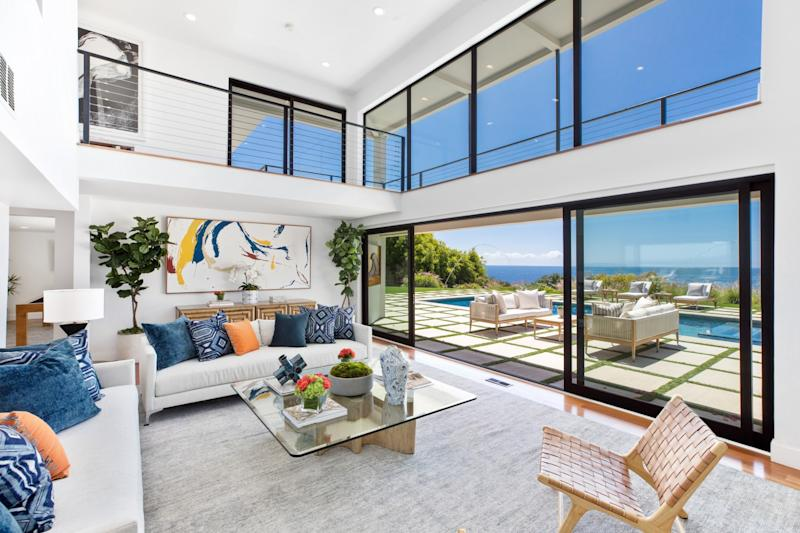The contemporary-style house faces a beach where Robert Conrad learned to surf in the 1950s.
