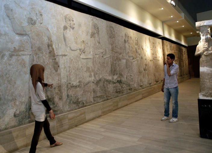 People visit the restored Iraqi National Museum in Baghdad, Iraq, Monday, April 1, 2013. Tens of thousands of artifacts chronicling some 7,000 years of civilization in Mesopotamia are believed to have been looted from Iraq in the chaos which followed the the US-led invasion in 2003. Despite international efforts to track items down, fewer than half of the artifacts have so far been retrieved. (AP Photo/Hadi Mizban)