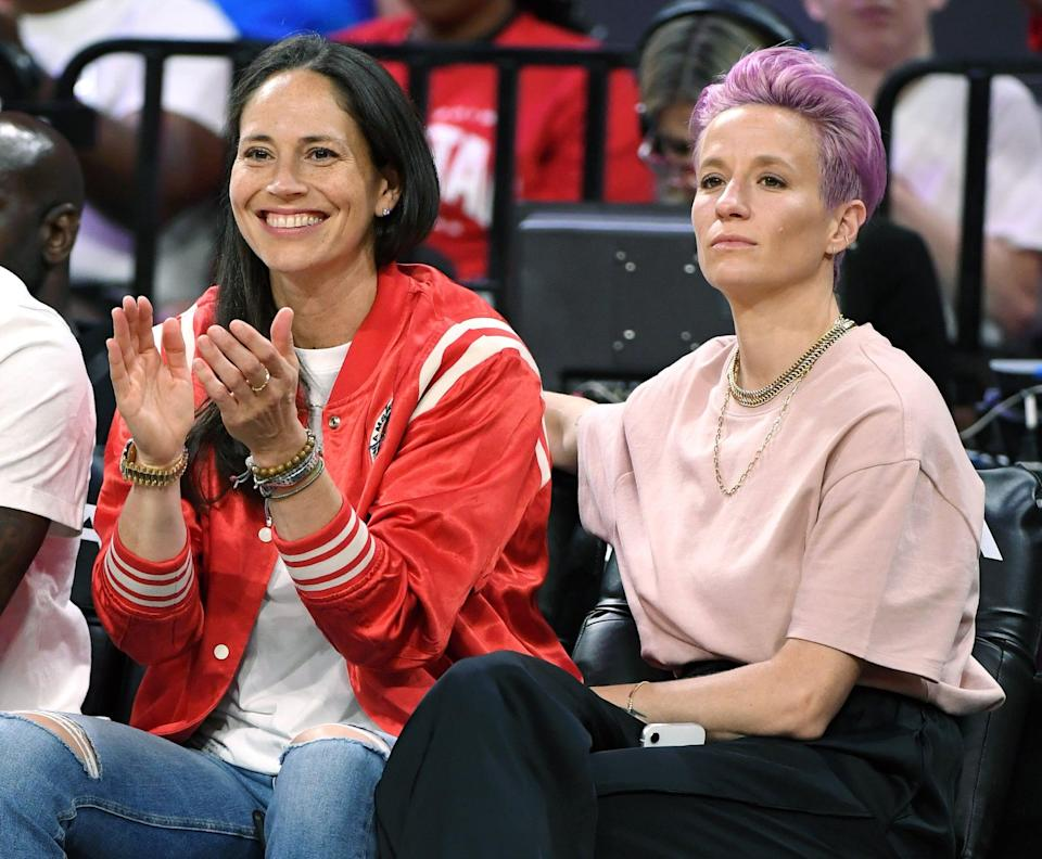 """<p>Yep, Rapinoe is one half of a sports power couple. She met basketball star Sue Bird at a sponsor event at the 2016 Olympics and they started dating that September. Bird plays for the WNBA's Seattle Storm and Megan is a forward for the Seattle Reign, and between them, the power couple has a ton of hardware: Bird has four Olympic gold medals and two WNBA titles under her belt, while Rapinoe has her own Olympic gold, plus two World Cup titles. They were also the <a href=""""https://www.espn.com/video/clip/_/id/23816827"""" class=""""link rapid-noclick-resp"""" rel=""""nofollow noopener"""" target=""""_blank"""" data-ylk=""""slk:first gay couple to appear in ESPN Magazine's Body Issue"""">first gay couple to appear in ESPN Magazine's Body Issue</a>, and Rapinoe helped Bird see the importance of <a href=""""https://www.seattletimes.com/sports/storm/seattle-meet-your-sports-power-couple-sue-bird-and-megan-rapinoe/"""" class=""""link rapid-noclick-resp"""" rel=""""nofollow noopener"""" target=""""_blank"""" data-ylk=""""slk:publicly talking about her sexuality"""">publicly talking about her sexuality</a>. """"Megan and I would have conversations about it, and she opened my eyes to another way of looking at it, which is that in today's time, in today's society, it's still important to kind of say it to make it the norm,"""" Bird told the Seattle Times in 2018.</p>"""