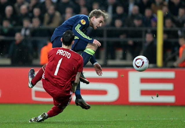 Dutch side Ajax Amsterdam's Christian Eriksen (back) scores a goal past Belgian RSC Anderlecht's goalkeeper Silvio Proto (front) during their Europa League 1/16 finals match on February 17, 2011, in Brussels. AFP PHOTO/BELGA /VIRGINIE LEFOUR (Photo credit should read VIRGINIE LEFOUR/AFP/Getty Images)