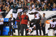 Tampa Bay Buccaneers cornerback Jamel Dean (35) intercepts a pass intended for Philadelphia Eagles wide receiver Quez Watkins (16) during the first half of an NFL football game Thursday, Oct. 14, 2021, in Philadelphia. (AP Photo/Matt Slocum)