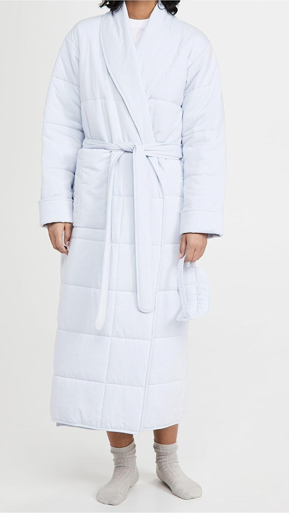 <p>This <span>Skin Sierra Robe with Eyemask</span> ($225) is looks stylish and is warm.</p>