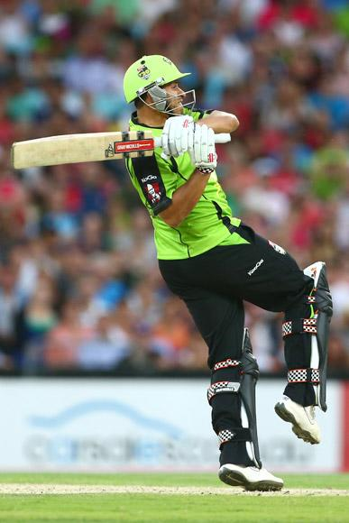 Usman Khawaja of the Thunder bats during the Big Bash League match between Sydney Thunder and the Sydney Sixers at ANZ Stadium on December 30, 2012 in Sydney, Australia.  (Photo by Mark Kolbe/Getty Images)