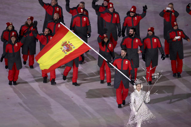 <p>Lucas Eguibar carries the flag of Spain during the opening ceremony of the 2018 Winter Olympics in Pyeongchang, South Korea, Friday, Feb. 9, 2018. (Sean Haffey/Pool Photo via AP) </p>