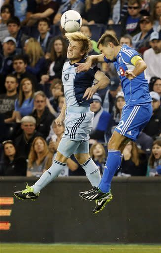 Sporting KC defender Seth Sinovic (15) and Montreal Impact midfielder Davy Arnaud (22) vie for the ball during the first half of an MLS soccer match in Kansas City, Kan., Saturday, March 30, 2013. (AP Photo/Orlin Wagner)