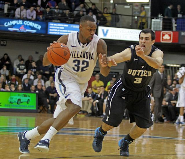 Butler's Alex Barlow (3) defends as Villanova's James Bell (32) drives into the lane in the first half of an NCAA college basketball game onWednesday, Feb. 26, 2014, in Villanova, Pa. (AP Photo/H. Rumph Jr.)