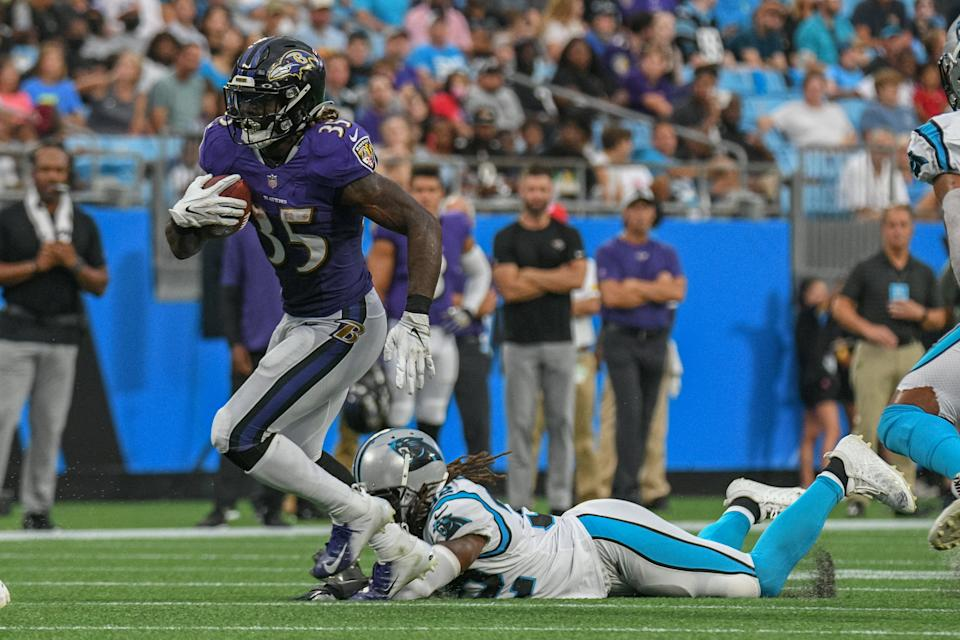CHARLOTTE, NC - AUGUST 21: Baltimore Ravens running back Gus Edwards (35) breaks a tackle during the preseason game between the Baltimore Ravens and the Carolina Panthers at Bank of America Stadium on August 21, 2021 in Charlotte, NC. (Photo by William Howard/Icon Sportswire via Getty Images)