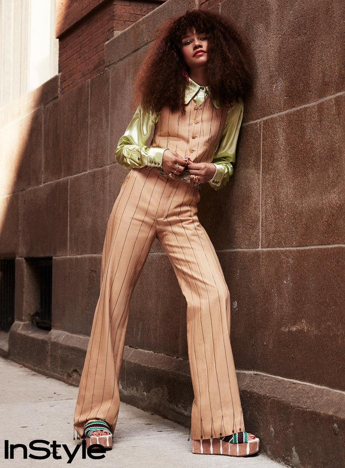 <p>Zendaya in an Acne Studios vest, shirt, trousers, and belt with&nbsp;Lunch at the Ritz for Brandon Maxwell<b> </b>earrings,&nbsp;Jennifer Fisher rings, and&nbsp;DVF<b> </b>flatforms.</p>