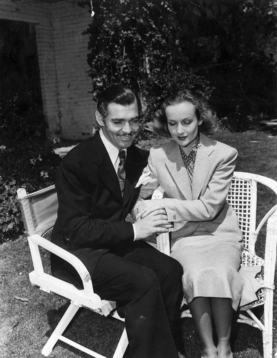 """<p>Screen legend Clark Gable and actress Carole Lombard pose for a photo shortly after their marriage ceremony in 1939. Gable wed Lombard during a production break on <em> Gone with the Wind.</em> The two were married for three years, until her untimely death in a plane accident in 1942. He went on to say """"I do"""" two more times – and was married to Kay Williams at the time of his death in 1960.</p>"""