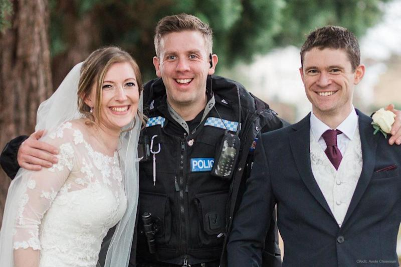 Police officer poses with happy couple: Thames Valley Police