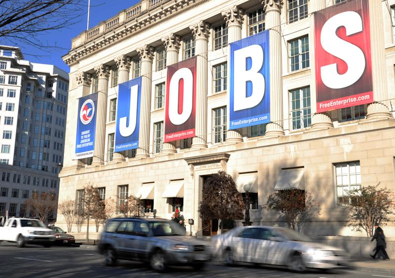 A jobs sign hangs above the entrance to the US Chamber of Commerce building in Washington, DC on December 13, 2011. New claims for US unemployment insurance dropped last week to a level last seen more than three years ago, government data showed December 15, 2011 in a sign of stabilization in the troubled jobs market. Initial jobless claims fell by 19,000 in the week ending December 10 from the prior week, to 366,000, the Labor Department said. AFP PHOTO / Karen BLEIER (Photo credit should read KAREN BLEIER/AFP via Getty Images)