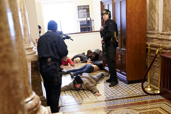 FILE - In this Jan. 6, 2021, file photo, U.S. Capitol Police hold rioters at gun-point near the House Chamber inside the U.S. Capitol in Washington. (AP Photo/Andrew Harnik, File)