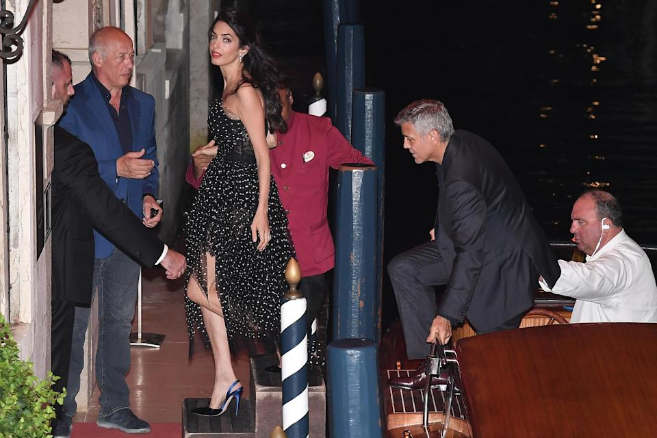 """<p><strong>When: August 31, 2017</strong><br>Ahead of the premiere of Clooney's crime-comedy flick """"Suburbicon,"""" at the 74th annual Venice Film Festival, Amal and George Clooney enjoyed a <a href=""""https://ca.style.yahoo.com/amal-clooney-dazzles-black-lace-slideshow-wp-165953385/photo-p-enjoying-more-low-key-photo-165953978.html"""" data-ylk=""""slk:romantic date night;outcm:mb_qualified_link;_E:mb_qualified_link;ct:story;"""" class=""""link rapid-noclick-resp yahoo-link"""">romantic date night</a> at Hotel Daniele, the historic hotel where they wed in back in 2014. <em>(Photo: Getty)</em> </p>"""