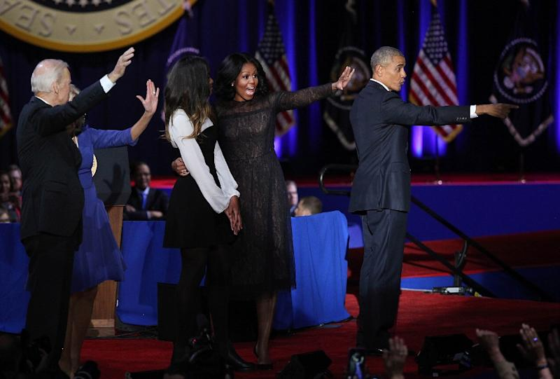 President Barack Obama (R), First Lady Michelle Obama (2L), daughter Malia Obama (C), Vice President Joe Biden (2L), and Jill Biden wave to supporters in Chicago (AFP Photo/Joshua LOTT)