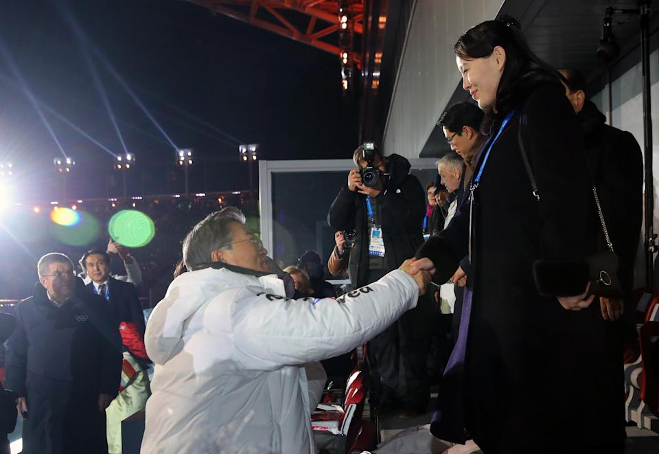 South Korean President Moon Jae-in (left) shakes hands with North Korea's Kim Yo Jong during the Opening Ceremonies. (AP)