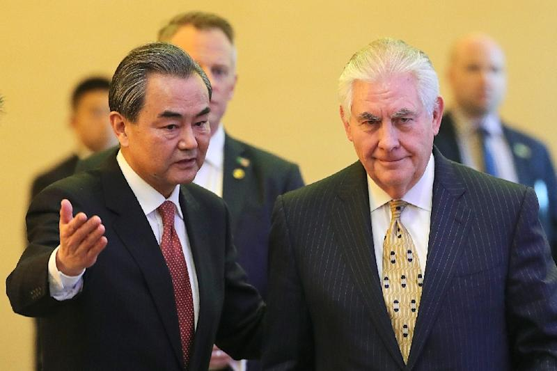 China's Foreign Minister Wang Yi (L) and US Secretary of State Rex Tillerson arrive for a joint press conference at the Diaoyutai State Guesthouse in Beijing, on March 18, 2017 (AFP Photo/Lintao Zhang)
